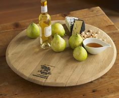 Our Wine Barrel Lazy Susan delivers dishes right to you with a simple flick of the wrist. Rotating in the center of the table, its displays the original imprint of the cooperage of origin. Did we mention that it's a converted oak barrel end, gainfully re-employed as a spinning server? Your personal message of up to 3 lines will be stenciled on. Made in USA.  #VivaTerra #made_in_America