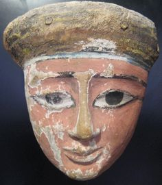"""Egyptian Polychrome Wood Mask - FF.086 Origin: Egypt Circa: 600 BC to 500 BC  Dimensions: 10"""" (25.4cm) high x 8.8"""" (22.4cm) wide  Collection: Egyptian Antiquities Medium: Wood"""