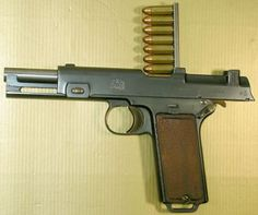 Steyer (Steyer-Hahn) M.1912, self-loading pistol, with clip inserted and cartridges ready to be pushed into the magazine.