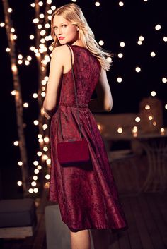 A look from our Inauguration Collection. A floral jacquard dress in a dramatic red is a quintessential party must-have. White House Black Market | Holiday Party Style