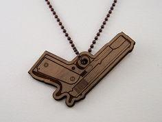 Laser cut walnut wood gun necklace, on Etsy