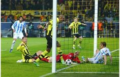 ~ Felipe Santana of Borussia Dortmund scoring the third and final goal against Malaga CF to advance to the semi-finals of the UEFA Champions League. This brought controversy because of his position beyond the second to last defender, clearly an offside position ~