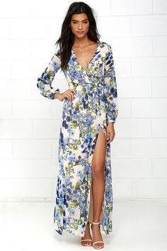 Take a moment to marvel at the sheer beauty of the Wondrous Water Lilies Blue Floral Print Maxi Dress! Floral print in shades of blue and green ripples across a beige chiffon backdrop as it shapes a surplice bodice framed by sheer long sleeves. A billowing maxi skirt with front slit falls below the elasticized waist for a stunning finish.