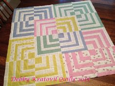 Debby Kratovil Quilts - 10 inch off center log Cabin  - good tut! love this quilt!!