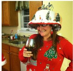 LOVE the hat! wacky holiday sweaters...