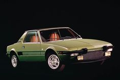 The legendary Fiat X 1/9 was produced from 1972 till 1978. Mine was all black. Could take corners like crazy!