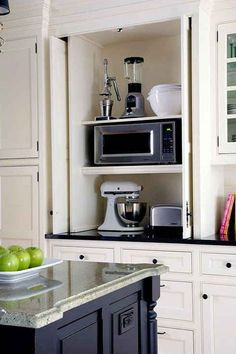 Hide appliances and counter clutter with folding or sliding doors in the kitchen cabinets - remodel idea 33 Insanely Clever Upgrades To Make To Your Home by eddie Kitchen Cabinet Remodel, Farmhouse Kitchen Cabinets, Kitchen Cabinet Organization, Kitchen Cabinet Design, Kitchen Pantry, Diy Kitchen, Kitchen Storage, Kitchen Appliances, Kitchen Ideas