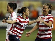 Lauren Cheney congratulates Carli Lloyd for her goal in a 2-0 win over China on Dec. 8, 2012. (Kirthmon F. Dozier/Detroit Free Press)
