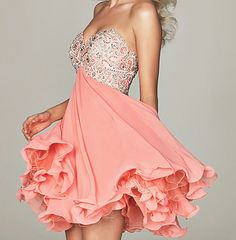 this dress has all the aspects of dream angels: pink/fun with the glitter/and feminine by it being flowy