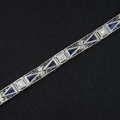 Original Art Deco Filigree Bracelet with Old European Cut Diamonds & Synthetic Blue Sapphires. The Diamonds are estimated at VS1 & 1/3rd carat. The sapphires are estimated 1.2 carat total. The deep blue sapphires are synthetic. Synthetic sapphires contain the same chemical properties as natural. Synthetic sapphires did not become commercially available until 1877 & were used frequently starting around 1903.  By the 1920-1930's, Synthetic Blue Sapphires were common in Art Deco jewelry.