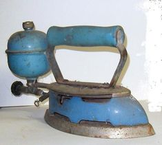 "old blue iron used liquid white gas. A little fire was lit inside. My mother liked this much better than the old ""sad irons"" that had to be heated on the kitchen range. Antique Iron, Vintage Iron, Retro Vintage, Vintage Items, Vintage Paper, Vintage Laundry, Vintage Kitchen, Vintage Sewing, Objets Antiques"