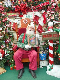 "Santa Claus holding his favorite book, ""The Night Before Christmas"" - at Santa Claus House in North Pole, Alaska ... just a little south of Fairbanks, AK 