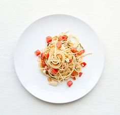 Pasta with Fresh Tomatoes: In a large bowl, combine diced tomatoes, salt, pepper, olive oil, red wine vinegar, minced shallot, minced garlic, slivered basil and shaved pecorino romano. Top with drained cooked pasta; let stand for a few minutes, then toss.