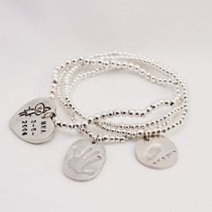 so cute this personal bracelet with little symbols from your child..