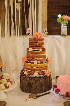 Rustic barn wedding style wedding cake decorated wtih flowers and berries. http://craigandkate.com/