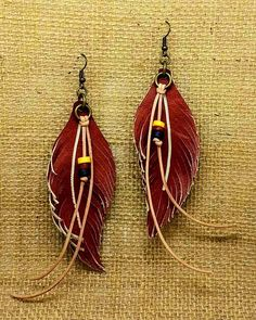 3 1/2 hand carved leather feathers, with natural leather and genuine buffalo bone trim. Nickle free antique brass trim. Just over 4 total drop. What do you have that wouldnt look great with these beauties?