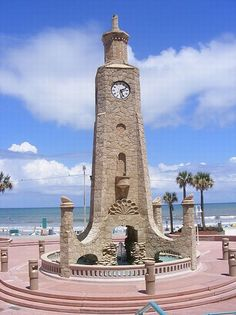 "The coquina clock tower at Daytona Beach -- underneath is a ""magic wishing well"" with fake bright blue water"
