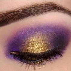 mardi gras anyone? all she needs is an emerald color lining below the eye