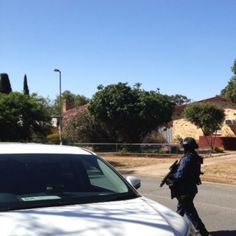 THE PRESENT- This photo is a police officer dressed in bulletproof vests and heavily armed. This photo was taken in the Northern Suburbs.  Elizabeth is now known as one of the most dangerous suburbs in Adelaide. This is seen through data about crime rates.