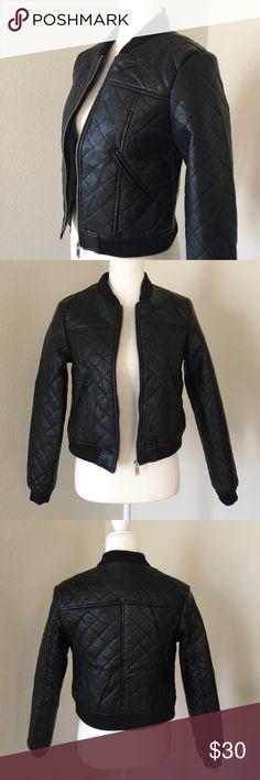 Quilted Moto Jacket Black quilted faux leather motorcycle jacket. Soft to the touch! Fully lined with front silver toned zipper. Pockets are accented only (don't open). (The mannequin is wearing a Large) NewLook Jackets & Coats