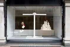 Windows at Selfridges London. Shows old books on one side and a castle made of papir from old books on the other.
