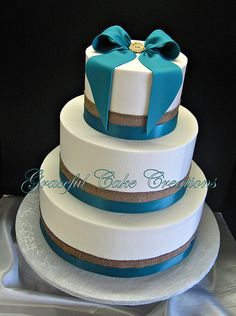 A Simple White Wedding Cake with Burlap and Teal Blue Ribbon and Bow