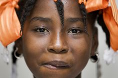 A portrait of a girl during a food distribution by Peruvian UN peacekeepers in Port-au-Prince, Haiti.  UN Photo/Marco Dormino