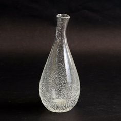 "Kaj Franck for Iittala, Finland Unique leaning hand blown clear glass vase internally decorated with tiny bubbles, Height 8 Width Engraved ""K Franck - Iittala""More items by Kaj Franck More Iittala"