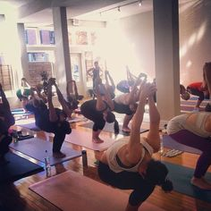 How low can you go? Utkatasana with hands bound at Southtown Yoga