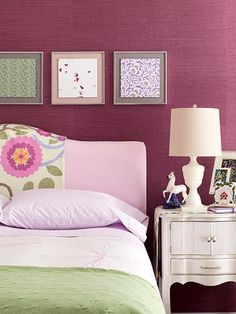 Love the large-scale patterned fabric drapes over the headboard and the patterned artwork above the bed.