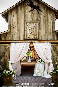 We are swooning over this barn entrance at @castletonfarms! Perfect for a Knoxville ceremony or reception! Click the image to contact them today about your wedding! Image credit: Waldorf Photographic Art.