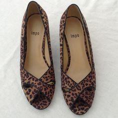 Leopard low Heels Suede feel Super cute leopard heels. Suede like fabric upper. Leather outsole. Minor wear. Impo Shoes Heels