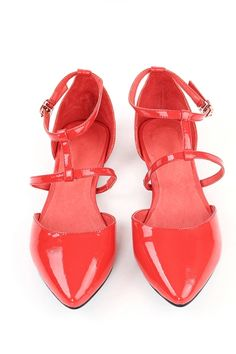 Flats crafted in PU, featuring pointed toe, cut out to main, ankle strap with pin buckle fastening, in slip on style.