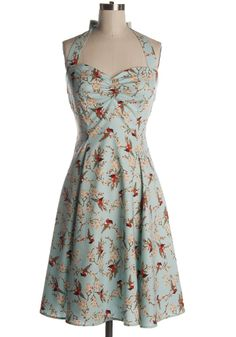 Oh my word, this 1950s inspired halter neck dress is so, so immensely darling! (Don't you just adore the red robin print? I do!) #dress #vintage #clothing #1950s #clothing #birds #halter