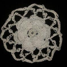 An Irish crochet rose and lattice - Pattern in: The Go-to Book for Irish Crochet Motifs http://www.amazon.co.uk/gp/product/1596359234