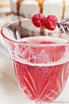 Crémant with raspberry syrup and fruit skewers
