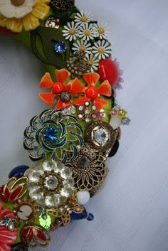 wreath form, vintage brooches, earrings, costume jewelry etc. FAB!