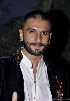 Ranveer Singh shows off his new short hairstyle, long handlebar moustache and a beard. via Voompla.com