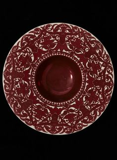 Plate        Place of origin:        Merton Abbey, England (probably, made)      Date:        late 19th century (made)      Artist/Maker:        De Morgan, William Frend, born 1839 - died 1917 (maker)      Materials and Techniques:        Earthenware painted in ruby lustre