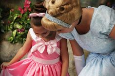 Aww! I love that the little girl is wearing the Cinderella dress the mice made for Cinderella in the movie!
