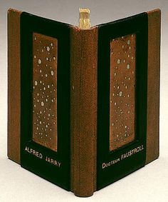 Gestes et opinions du Docteur Faustroll, pataphysicien (The Exploits and Opinions of Doctor Faustroll, Pataphysician) by Alfred Jarry. Mary Reynolds and Marcel Duchamp. Paris: Librairie Stock, 1923. Binding: brown leather stamped in herringbone pattern, black morocco (goatskin), copper sheeting, and green glassine endpapers. Reynolds created this binding based on Duchamp's windows, Fresh Widow (1920) and Brawl at Austerlitz (1921).