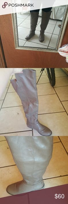 Over the knee boots size 10 with side zip Excellent condition.  Purchased at boutique. The first pic taken indoors, so color appears slightly darker than actually is.  The other photos show the trueer color.  It's a beautiful color amd goes with everything!  I'm 5'8 and this reaches above my knees. Shoes Over the Knee Boots