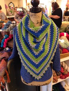 Crochet Rainbow Shawl in honor of the Seattle Seahawks. Used Cascade Yarns Heritage - gray, green and blue.