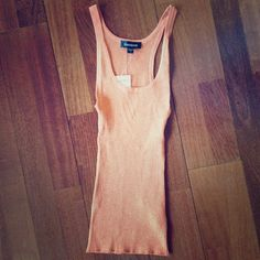 BEBE NWT SHIMMERY ORANGE TOP Brand new with tags and never worn!  Beautiful orange top with a shimmery effect.  Make an offer bebe Tops Tank Tops
