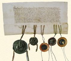 When the Swiss decided they wanted to go to war with Charles, Berne removed its wax seal from this treaty for peace that they had signed with Burgundy in 1467.  Here you can see the two holes left by the absence of the Swiss seal.   And here is Philippe le Bon's wax seal, clearly recognizable on the left, made perhaps, using the great gold seal-die above.