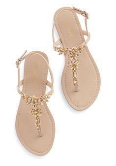 You won't have to convince your pals that you know all about standout style - these gemstone sandals prove it! Glistening, floral-shaped gems and bitty rhinestones sparkle atop the T-strap silhouette of these beige sandals, shining as brightly as the smile that forms on your face as soon as you buckle them up!