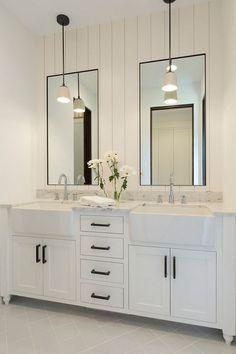 Bathroom shiplap wall behind mirrors. Bathroom with shiplap wall behind mirrors…: