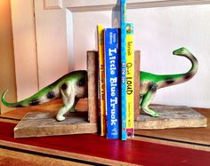 Pair Reclaimed Wood Pallet Wood Dinosaur Bookends Nursery Child's Room Rustic Cottage Vintage by mybestfriendnme on Etsy https://www.etsy.com/listing/178150411/pair-reclaimed-wood-pallet-wood-dinosaur