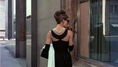 breakfast-at-tiffanys-black-evening-dress,  with the ecology of pearls via Eluxe magazine