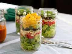 Nacho Salad recipe from Trisha Yearwood via Food Network. Instead of jars put in bowl and put dressing on right before serving.